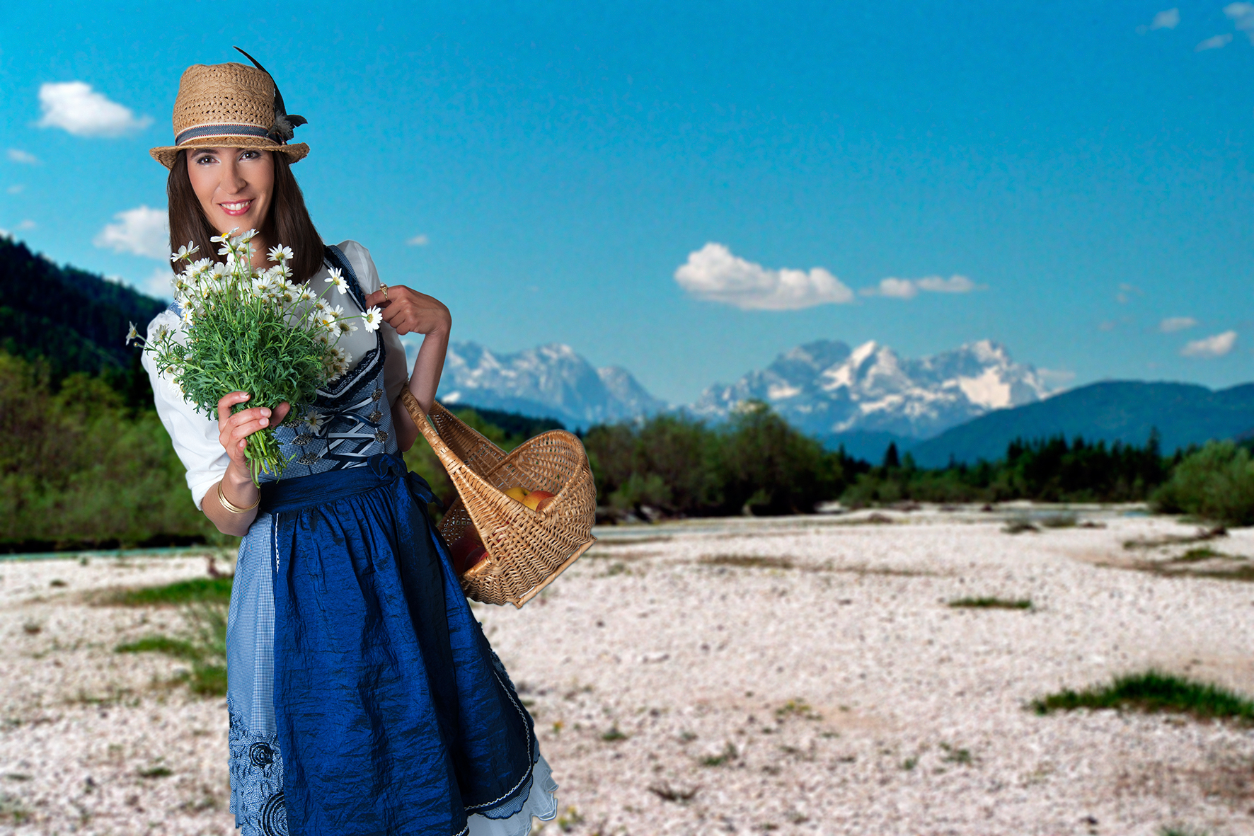 Fashionable_young_woman_posing_in_bavarian_dress_with_flowers_in_bavarian_landscape_by_studioblom.de